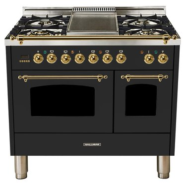 Double oven stove in black with brass hardware