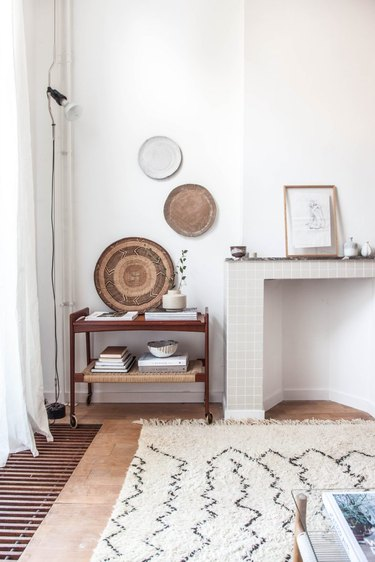 neutral living room wall decor idea with woven baskets on wall
