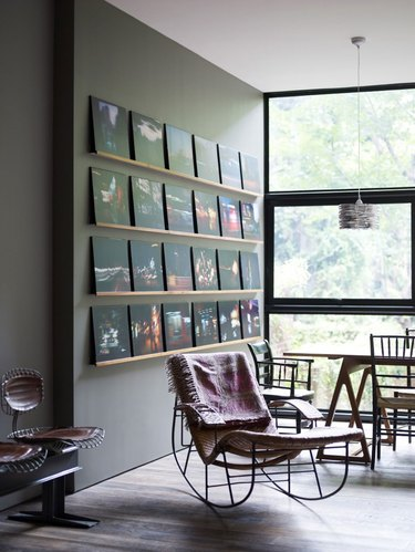 contemporary living room wall decor idea with statement gallery wall
