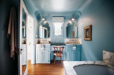 Light blue calming colors in bathroom with marble countertops.