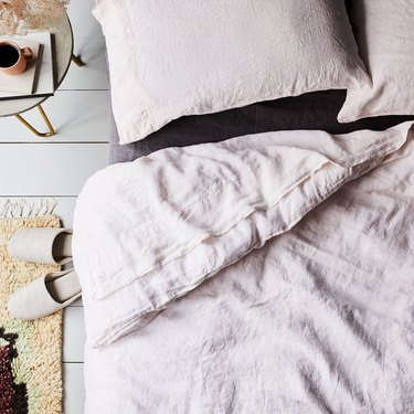 Choose natural materials, like linen, for sleeping in warmer months
