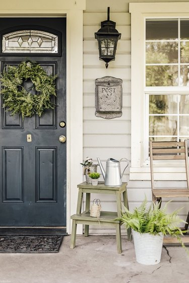 black front door color with green wreath