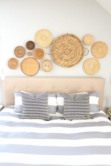 basket decor, baskets above bed, basket wall decor