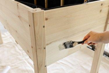Painting white shellac primer on wood planter box