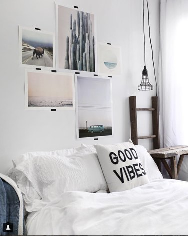 pictures above bed, art above bed