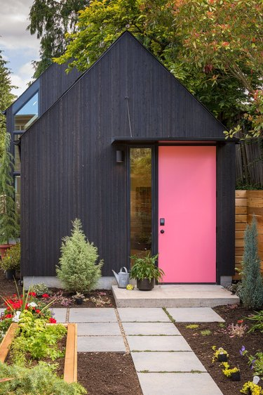 pink front door color on matte black house