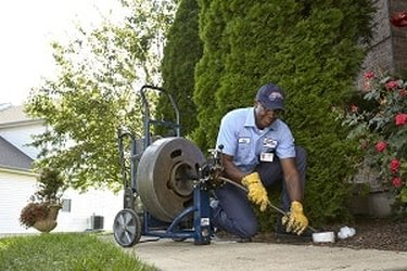 Clearing out a sewer.