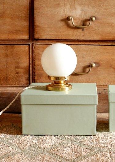 decorative lamp near dresser