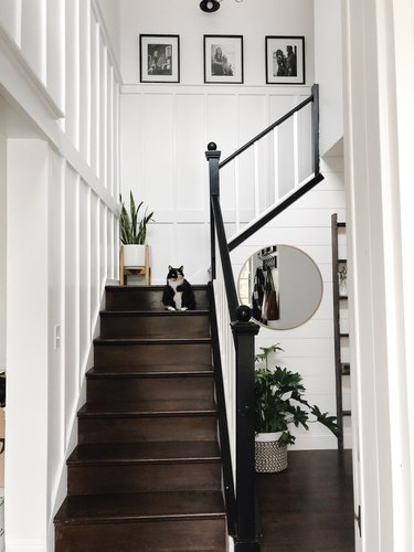 Wood stairs with white board and batten wall panels