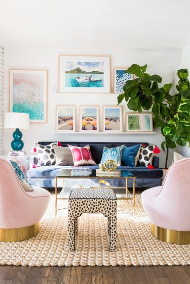 modern living room makeover idea with pink velvet chairs and colourful cushions