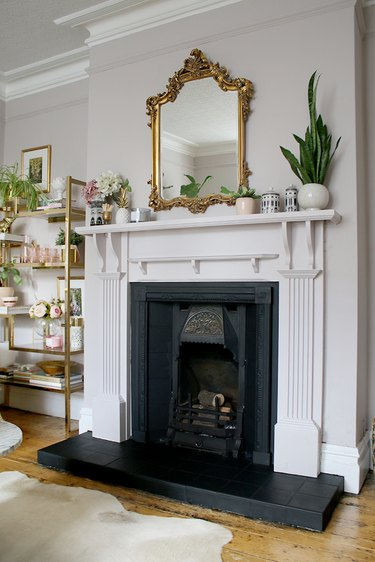 neutral living room makeover idea and fireplace with gold details