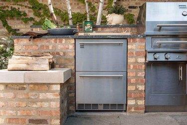 brick outdoor kitchen idea with stainless steel refridgerator