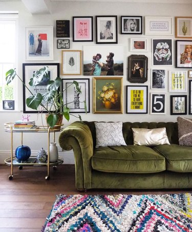 eclectic living room makeover idea with gallery wall and velvet sofa