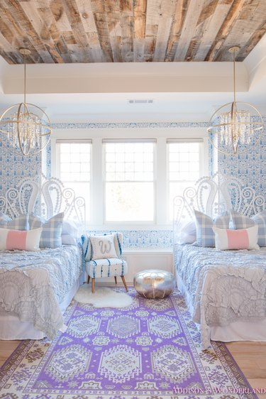 rustic girls bedroom idea with wood ceiling and patterned blue wallpaper