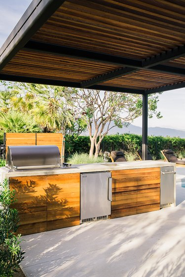 covered outdoor kitchen idea with stainless steel appliances