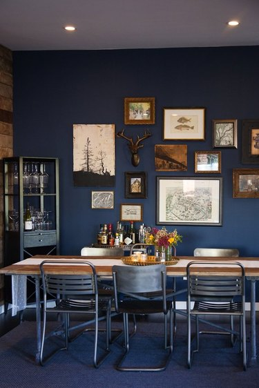 Rustic blue dining room with gallery wall