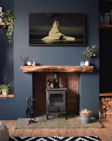 Rustic blue living room with fireplace and wood floor