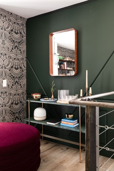 colors that go with green, burgundy ottoman next to green wall with green console table