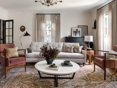 living room space with gray couch, two chairs and white coffee table