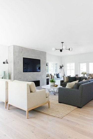 concrete living room TV idea built-in to fireplace surround