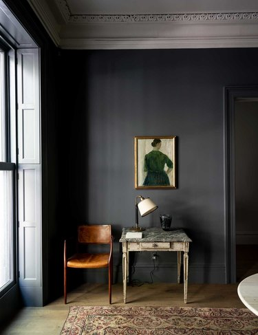 charcoal color living room with chair and table