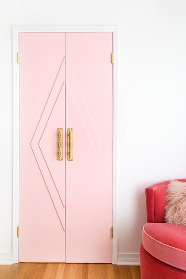 Pink closet door ideas for bedrooms with brass hardware