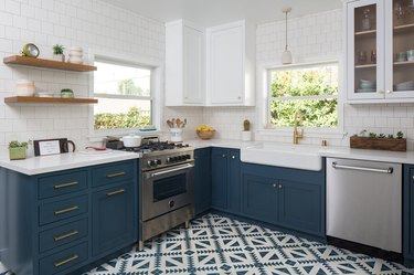 Patterned kitchen floor tile idea with blue cabinets and open shelving