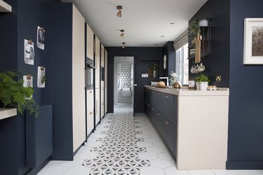Kitchen floor tile idea with navy blue cabinets
