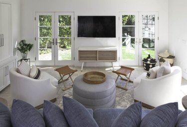 Living room TV idea flanked by French doors