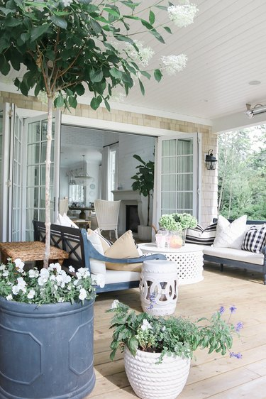 outdoor patio area with sofas and coffee table