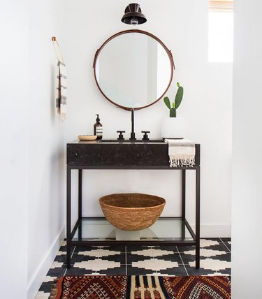 Bathroom organization idea with shelf under console sink and patterned floor tile