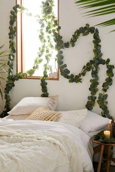 vine garland above white bed