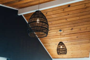 black pendant lights hanging from wood ceiling