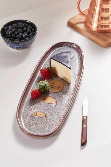 serving platter with knife nearby