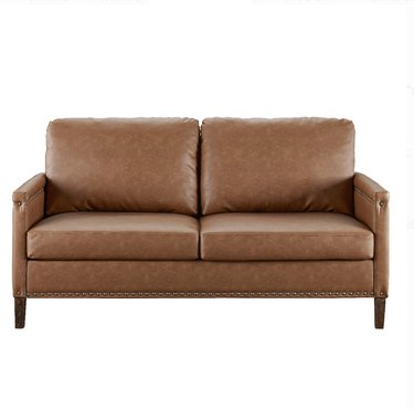 faux leather couch with nailhead detailing