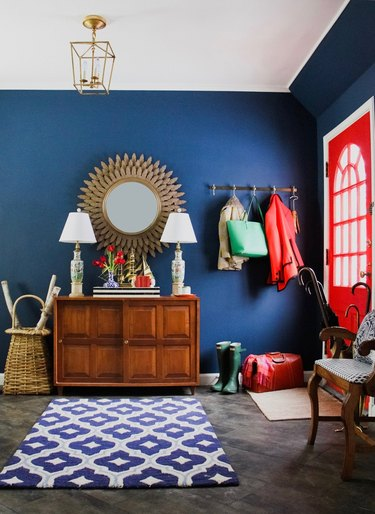 Pantone Color of the Year Classic Blue in an entryway paired with a red door