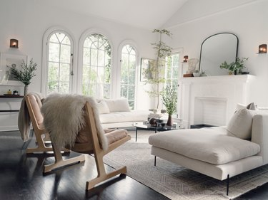 white Scandinavian fireplace in living room with wood flooring