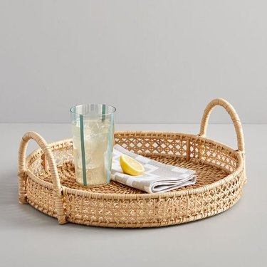 rattan tray with a beverage and napkin
