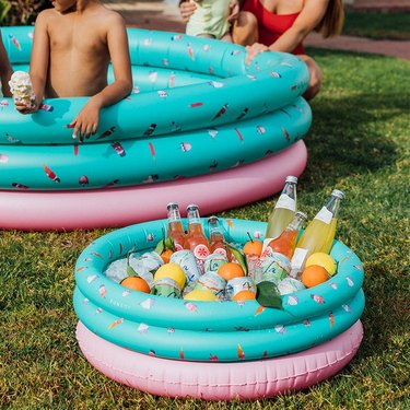 Blow-up pool with matching teal and pink blow-up cooler