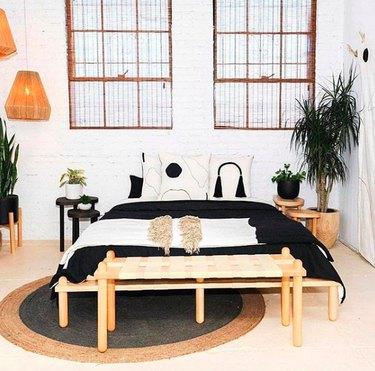 Black, white, and wood minimal bedroom