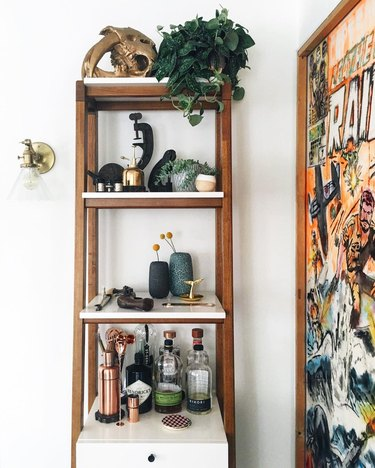 living room bar idea with bohemian shelving and oversize poster print