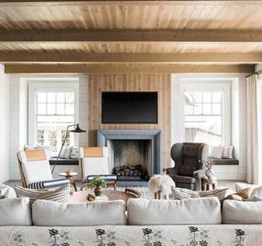 Living room TV idea with wood fireplace surround
