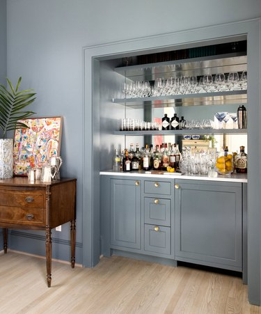 grayish blue paint color in dry bar with shelves and glasses