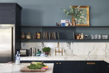 Blue paint color in the kitchen with marble counters