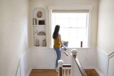 Woman sitting at bay window