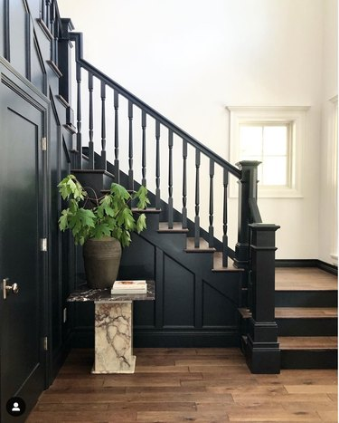 traditional black stair railing with wood steps