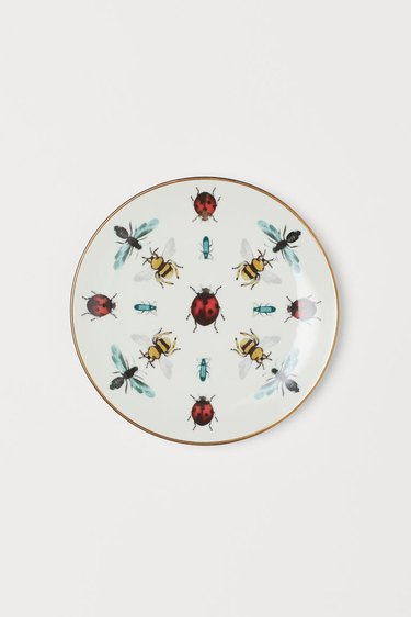 small porcelain plate with bug pattern