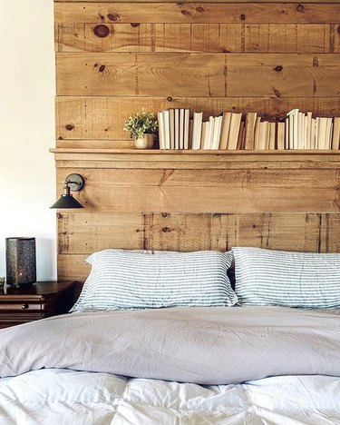DIY rustic headboard with shelf and wall sconces