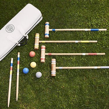 Croquet mallets in the grass