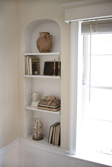 Styled shelf next to a bay window